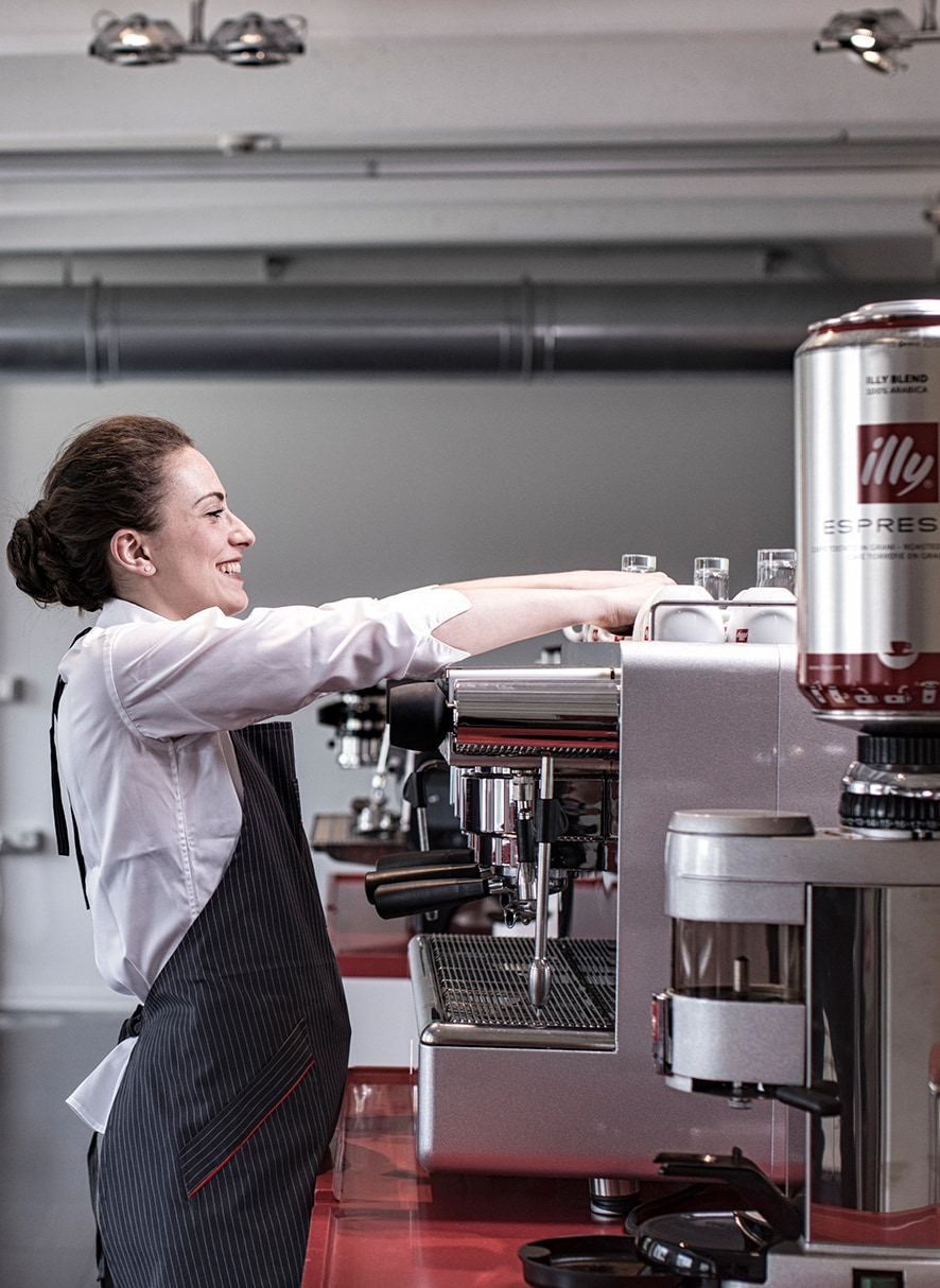 illy professional barista making coffee