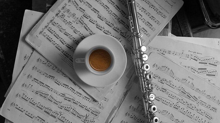 Coffee cup on music shore