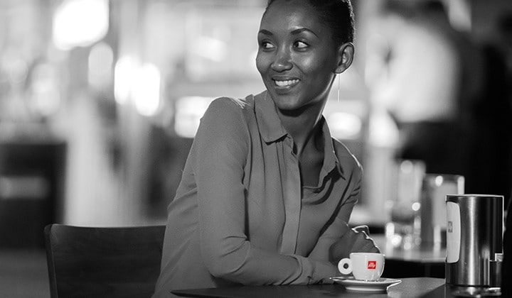Philotée Mukiza with an illy coffee cup